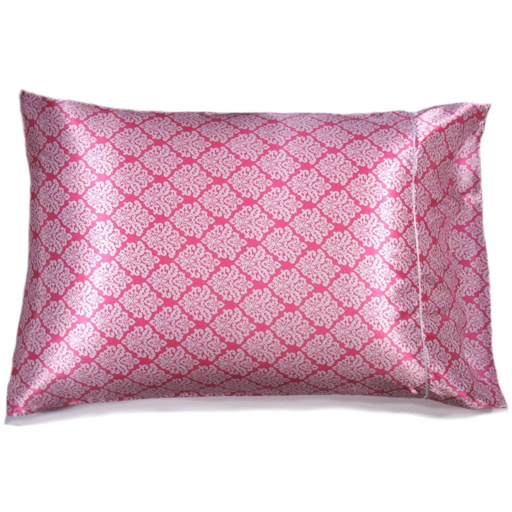 This travel pillow is made from a pink and white  satin print. The pillow feels