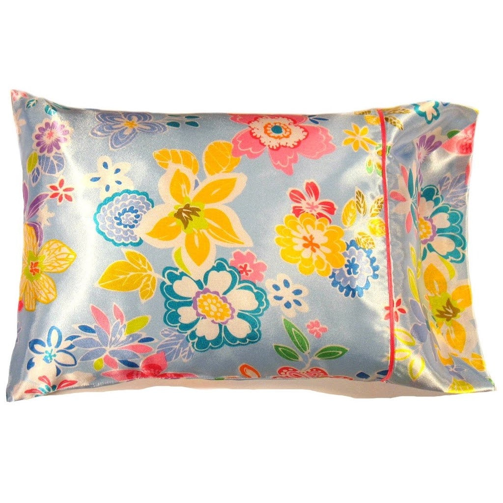 This decorative bedroom pillow is made from a blue. yellow and pink  satin print. The pillow feels