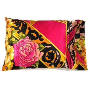 "This boudoir pillow is made from a pink rose with gold and black  satin print. The pillow feels ""down filled"" and is hypo-allergenic. The pillow and pillowcase are washable."