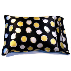 "This sofa nap pillow is made from a black with large white and yellow polka dots  satin print. The pillow feels ""down filled"" and is hypo-allergenic. The pillow and pillowcase are washable."