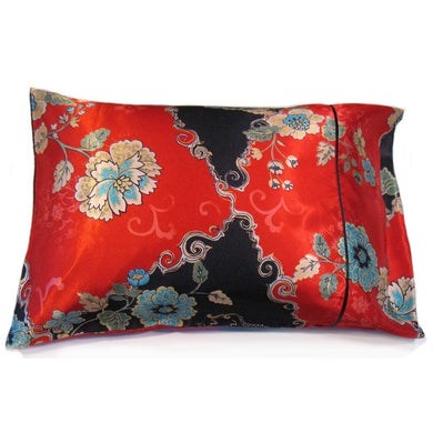 This sofa nap pillow is made from a red and dark blue satin oriental print. The pillow feels