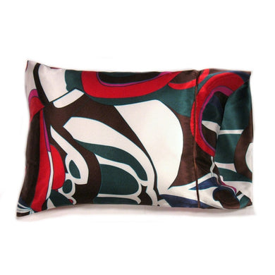 This sofa nap pillow is made from a white, green and red  satin print. The pillow feels