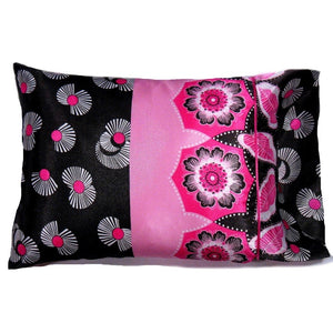 "This accent pillow is made from a pink and black charmeuse  satin print. The pillow feels ""down filled"" and is hypo-allergenic. The pillow and pillowcase are washable."