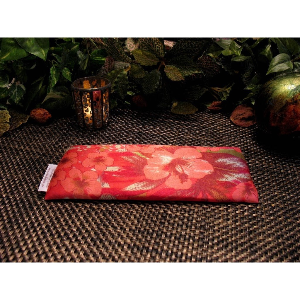 This yoga eye pillow is made with a pink and coral satin print, filled with organic flaxseed for unscented or choose organic lavender or peppermint for scented.