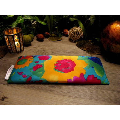 This eye pillow is made with a yellow and turquoise flowers satin print, filled with organic flaxseed for unscented or choose organic lavender or peppermint for scented.