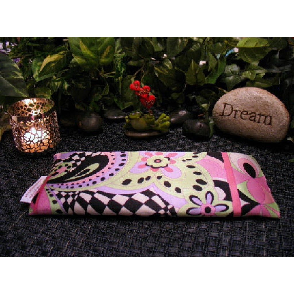 This meditation eye pillow is made with a pink and black satin print, filled with organic flaxseed for unscented or choose organic lavender or peppermint.