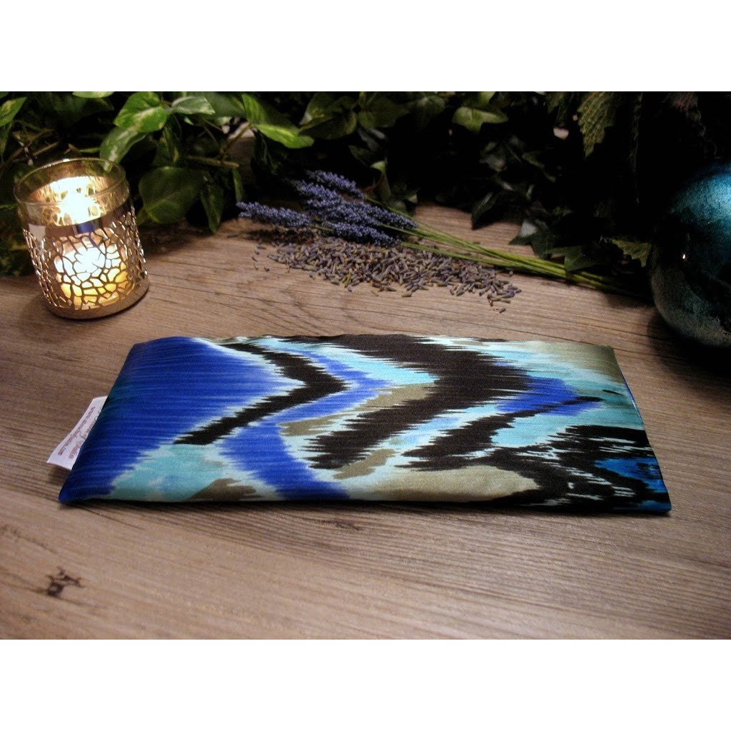This eye pillow is made with a blue and black satin southwestern print, filled with organic flaxseed for unscented or choose organic lavender or peppermint for scented.