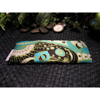 This yoga eye pillow is made with a green, white and black satin print, filled with organic flaxseed for unscented or choose organic lavender or peppermint for scented.