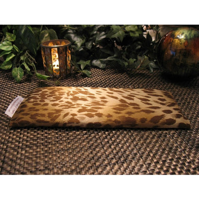 This yoga eye pillow is made with a brown and gold leopard satin print, filled with organic flaxseed for unscented or choose organic lavender or peppermint.