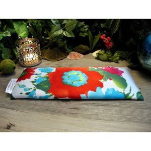 This eye pillow is made with a white, red and blue satin floral print, filled with organic flaxseed for unscented or choose organic lavender or peppermint for scented.