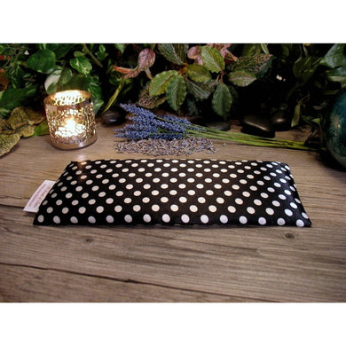 This aromatherapy eye pillow is made with a black and white polka dots satin print, filled with organic flaxseed for unscented or choose organic lavender or peppermint.