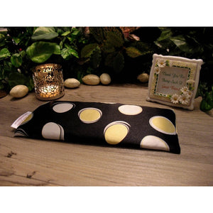 This flaxseed eye pillow is made with a large yellow and white polka dot satin print, filled with organic flaxseed for unscented or choose organic lavender or peppermint for scented.