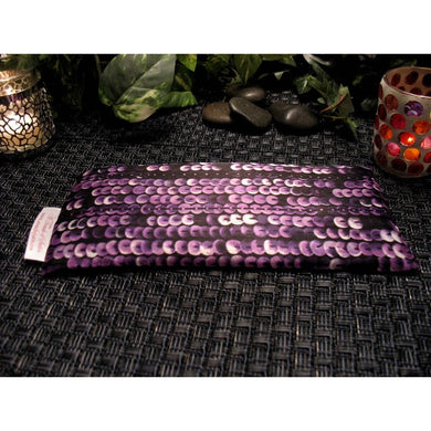 This aromatherapy eye pillow is made with a purple and black sequin satin print, filled with organic flaxseed for unscented or choose organic lavender or peppermint.