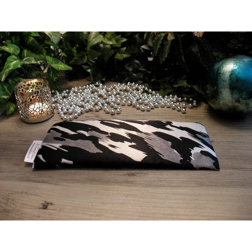 This eye pillow is made with a black, white and gray satin print, filled with organic flaxseed for unscented or choose organic lavender or peppermint for scented.