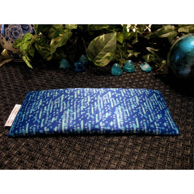 This yoga eye pillow is made with a blue satin print, filled with organic flaxseed for unscented or choose organic lavender or peppermint for scented.