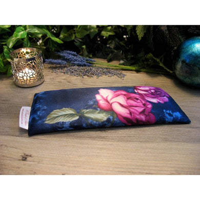 This aromatherapy eye pillow is made with a navy and pink roses satin print, filled with organic flaxseed for unscented or choose organic lavender or peppermint.