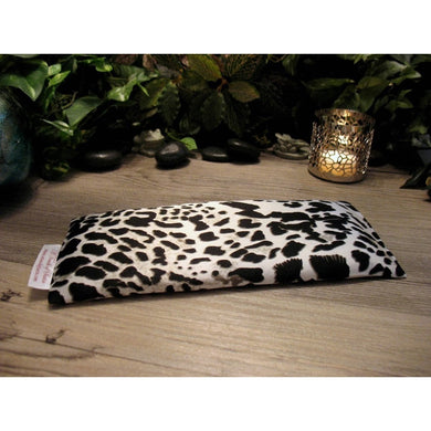 This yoga eye pillow is made with a black and white satin animal print, filled with organic flaxseed for unscented or choose organic lavender or peppermint.