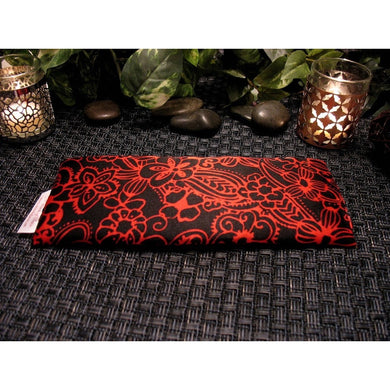 This eye pillow is made with a black and red satin print, filled with organic flaxseed for unscented or choose organic lavender or peppermint for scented.