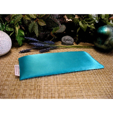 This eye pillow is made with turquoise blue satin, filled with organic flaxseed for unscented or choose organic lavender or peppermint for scented.