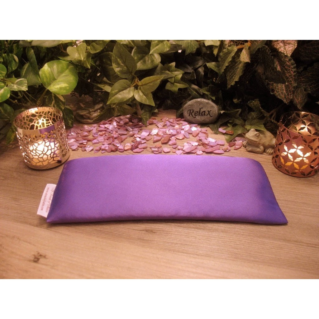 This eye pillow for yoga is made with purple satin, filled with organic flaxseed for unscented or choose organic lavender or peppermint for scented.