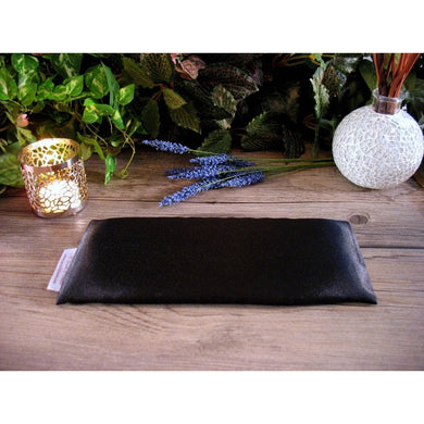 This unscented yoga eye pillow is made with black charmeuse satin and filled with organic flaxseed for unscented.