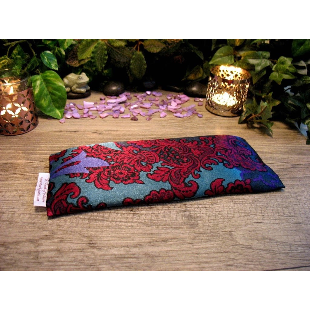 This lavender eye pillow is made with a red and green satin print, filled with organic flaxseed for unscented or choose organic lavender or peppermint for scented.