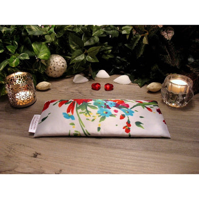 This eye pillow is made with a white, blue and red satin floral print, filled with organic flaxseed for unscented or choose organic lavender or peppermint for scented.