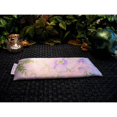 This meditation eye pillow is made with a pastel satin print, filled with organic flaxseed for unscented or choose organic lavender or peppermint for scented.