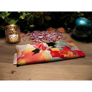 This eye pillow is made with a coral, red and black satin print, filled with organic flaxseed for unscented or choose organic lavender or peppermint for scented.