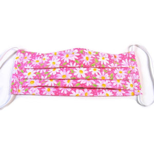 Pink with white flowers cotton face mask has a pocket in the back for a filter, a nose wire is sewn in for a secure fit and the mask is washable.