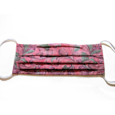 Pink with green leaves cotton face mask has a pocket in the back for a filter, a nose wire is sewn in for a secure fit and the mask is washable.