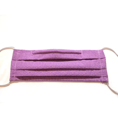 Purple cotton face mask has a pocket in the back for a filter, a nose wire is sewn in for a secure fit and the mask is washable.