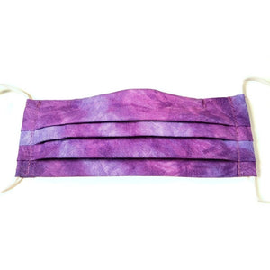 Purple tye dye cotton face mask has a pocket in the back for a filter, a nose wire is sewn in for a secure fit and the mask is washable.