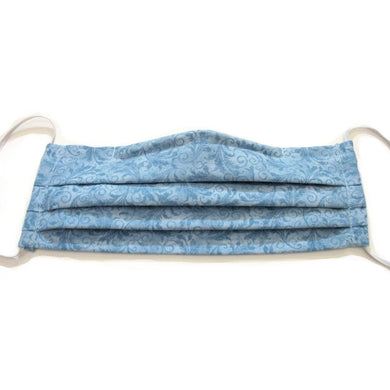 This powder blue print cotton face mask has a pocket in the back for a filter, a nose wire is sewn in for a secure fit and the mask is washable.