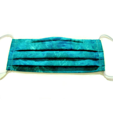 This turquoise blue print cotton face mask has a pocket in the back for a filter, a nose wire is sewn in for a secure fit and the mask is washable.