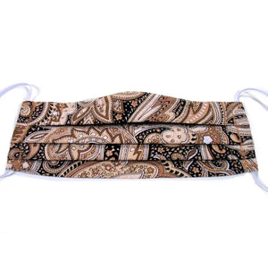 This brown and beige paisley print cotton face mask has a pocket in the back for a filter, a nose wire is sewn in for a secure fit and the mask is washable.