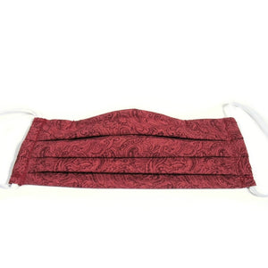 This burgundy paisley print  cotton face mask has a pocket in the back for a filter, a nose wire is sewn in for a secure fit and the mask is washable.