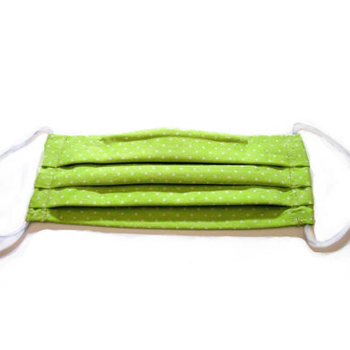 Our lime green cotton face mask has a pocket in the back for a filter, a nose wire is sewn in for a secure fit and the mask is washable.