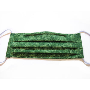 This green paisley print cotton face mask has a pocket in the back for a filter, a nose wire is sewn in for a secure fit and the mask is washable.