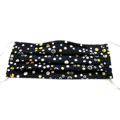 This white and yellow polka dot cotton face mask has a pocket in the back for a filter, a nose wire is sewn in for a secure fit and the mask is washable.
