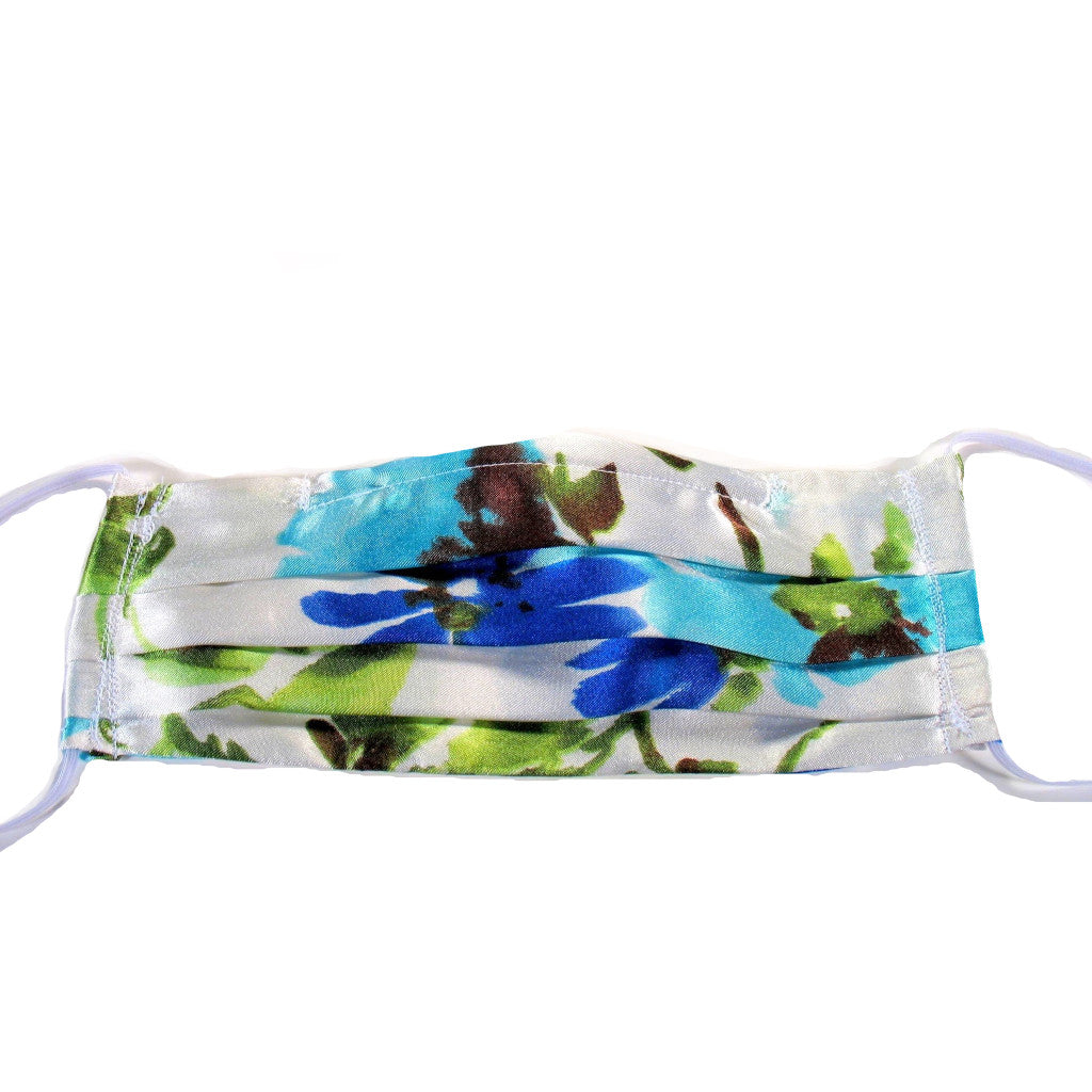 This white, blue turquoise print satin face mask has a pocket in the back for a filter, a nose wire is sewn in for a secure fit and is washable.