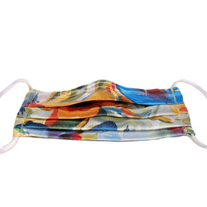 This orange, blue and white print satin face mask has a pocket in the back for a filter, a nose wire is sewn in for a secure fit and is washable.