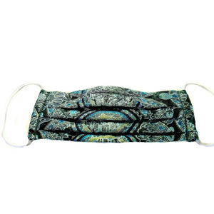 This green and turquoise print satin face mask has a pocket in the back for a filter, a nose wire is sewn in for a secure fit and is washable.
