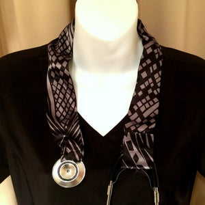 Our stethoscope cover is made from a black and taupe color charmeuse satin print and is washable. The cover has a Velcro closing to keep it in place.