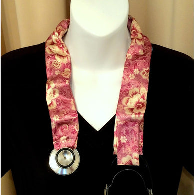 Our veterinarian stethoscope cover is made from a pink and cream flowers charmeuse satin print and is washable. The cover has a Velcro closing to keep it in place.