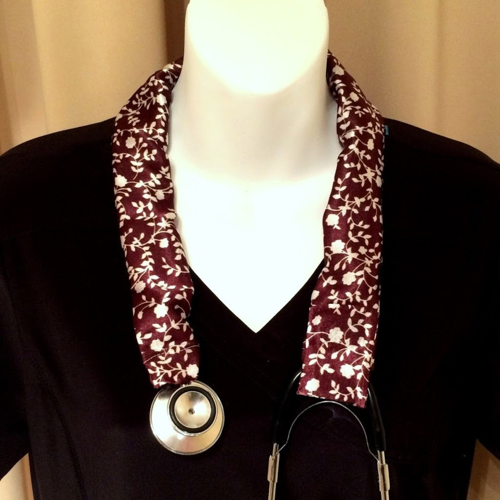 Our EMT stethoscope cover is made from a maroon and white charmeuse satin print and is washable. The cover has a Velcro closing to keep it in place.