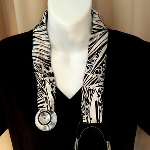 Our stethoscope cover is made from a black and white charmeuse satin print and is washable. The cover has a Velcro closing to keep it in place.