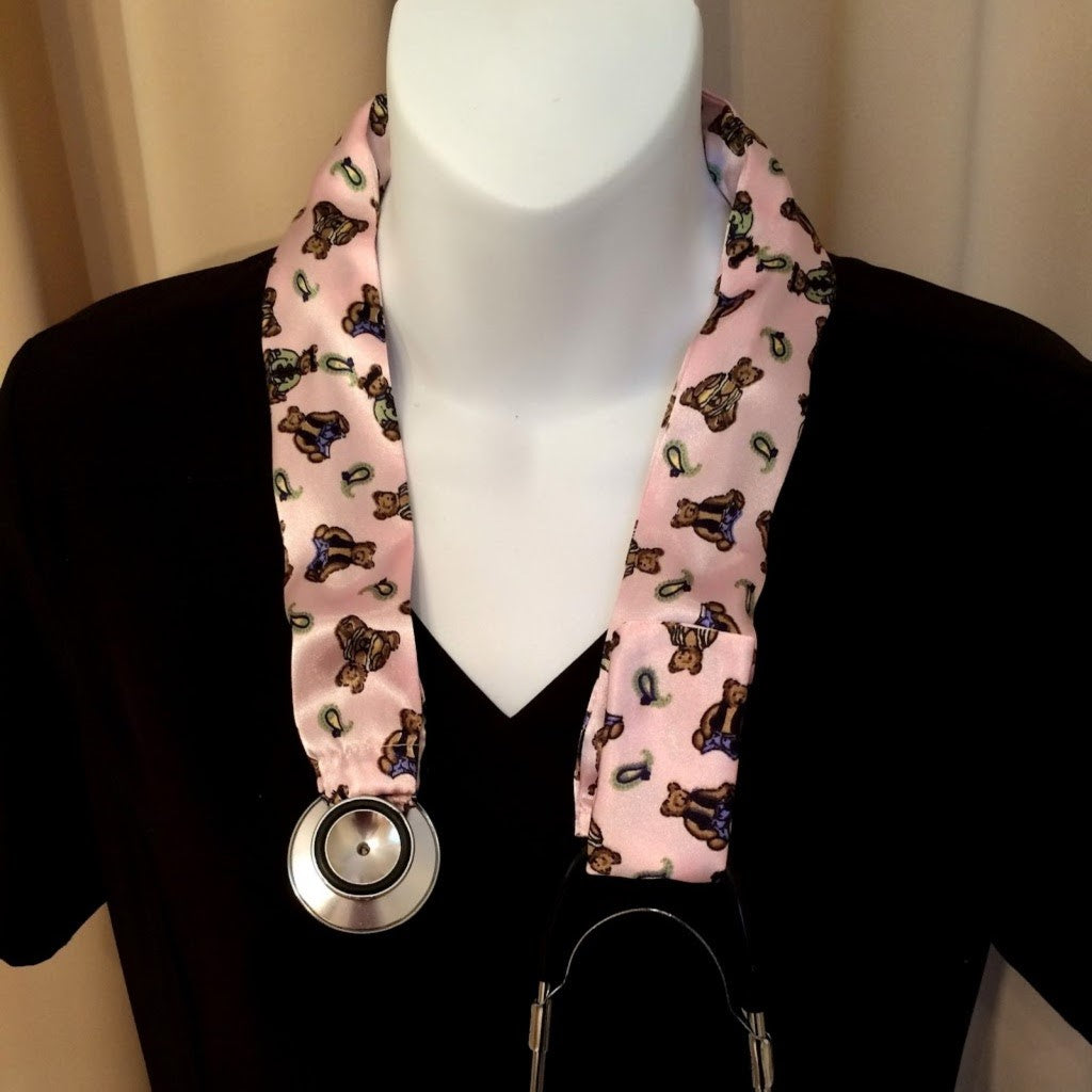 Our pink with little bears stethoscope cover is made from a charmeuse satin print and is washable. The cover has a Velcro closing to keep it in place.