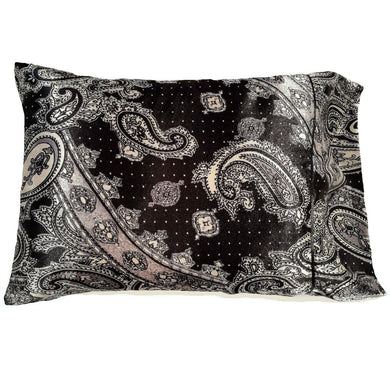 This decorative pillow is made from a black and gray satin paisley print. The pillow feels