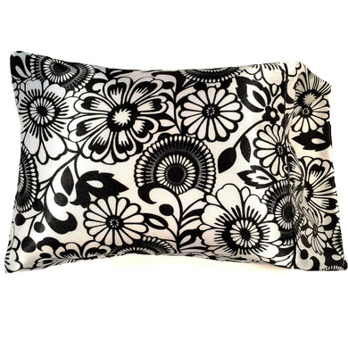 This travel/boudoir pillow is made from a black and white charmeuse satin print. The pillow feels
